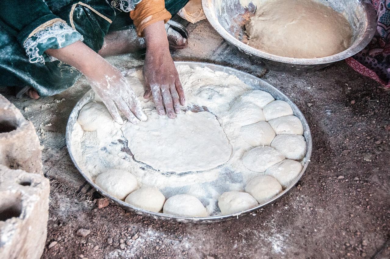 Woman cooking in Fenyan, Arabah, Jordan
