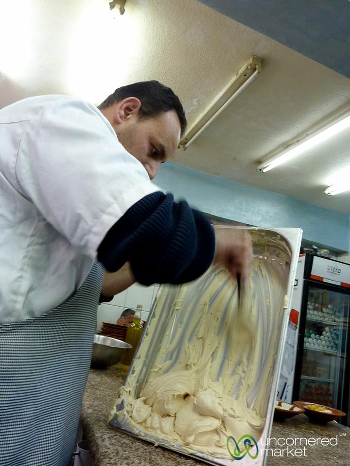 Scooping out the Hummus at Hashem - Amman, Jordan