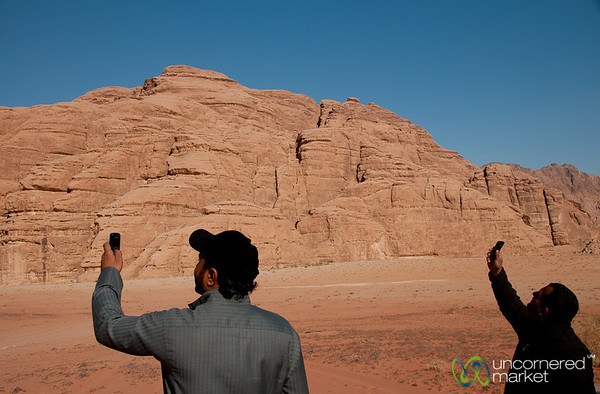 Bedouins Looking for a Mobile Phone Signal at Wadi Rum, Jordan
