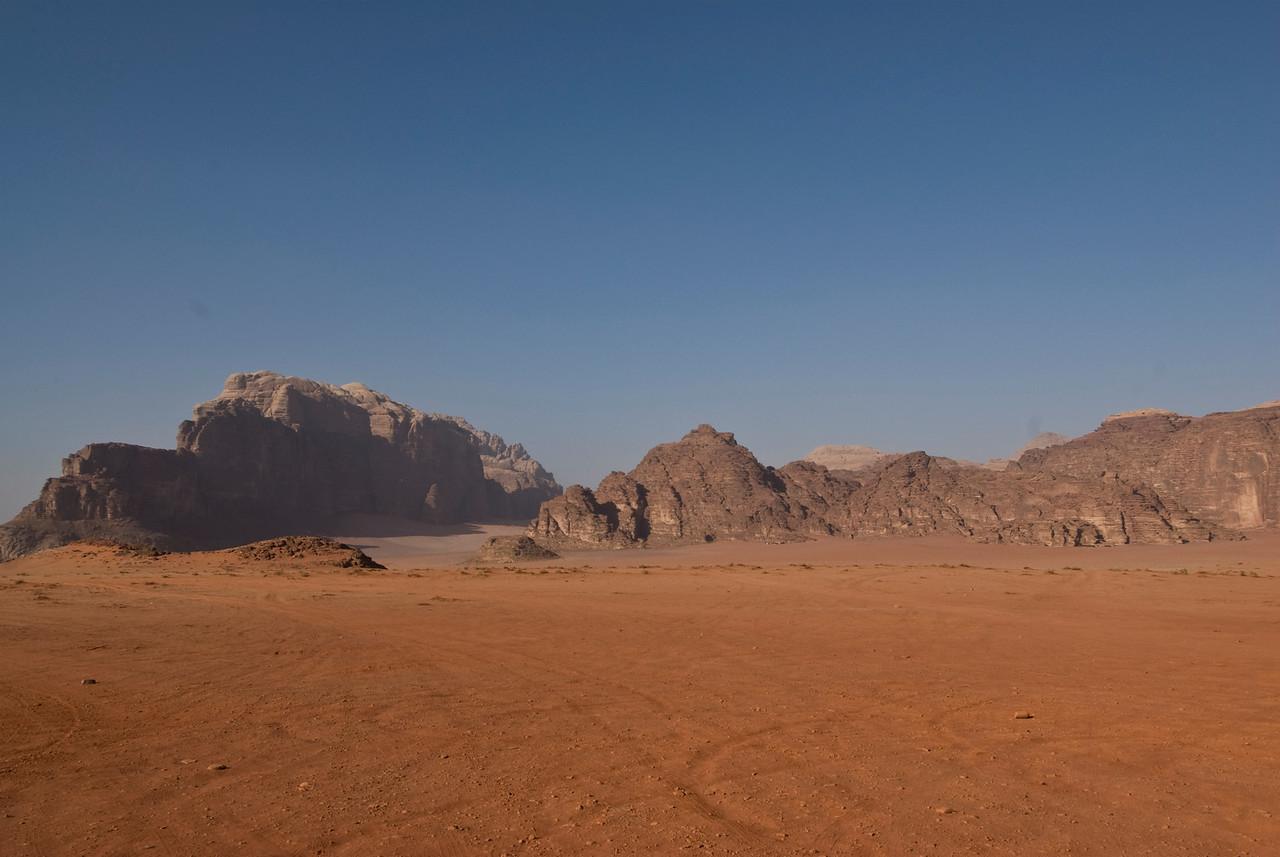 Desert with view of granite rock formation inWadi Rum, Jordan
