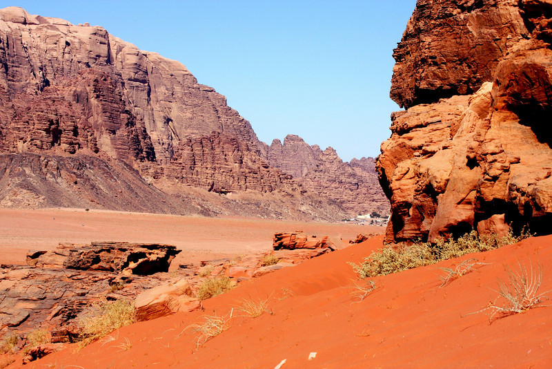 Wadi Rum (Arabic: وادي رم‎) is a broad valley of sandstone and granite in southwest Jordan. It is also the largest wadi in Jordan.  Wadi Rum, is well known in the US and Europe for its connection with British officer T. E. Lawrence, who based his operations here during the Arab Revolt of 1917–18.