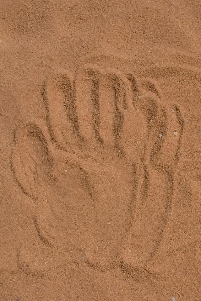 Hand print in the desert in Wadi Rum, Jordan