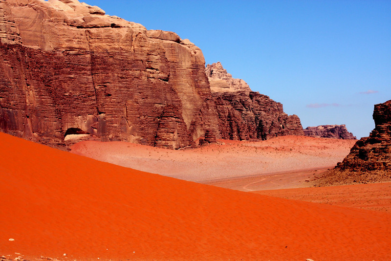 Wadi Rum (Arabic: وادي رم) is a broad valley of sandstone and granite in southwest Jordan. It is also the largest wadi in Jordan.  Wadi Rum, is well known in the US and Europe for its connection with British officer T. E. Lawrence, who based his operations here during the Arab Revolt of 1917–18.