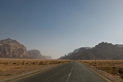 Road with view of rock formation in Wadi Rum, Jordan