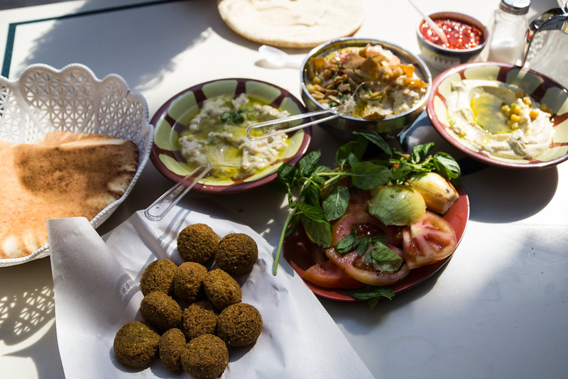 Typical Jordanian Meal with Falafel, Hummus and Other Bean Dips Sampled in Old Amman (©simon@myeclecticimages.com)