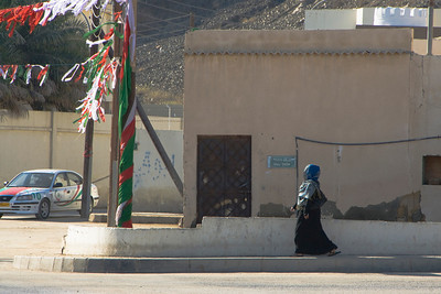 Woman Walking on Street - Muscat, Oman