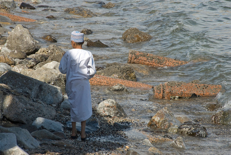 Boy near water in Muscat, Oman