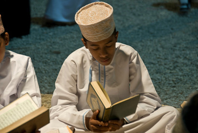 Boy reading the Koran in Muscat, Oman