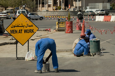 Men at work in the street of Nizwa, Oman