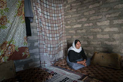 Shekhan,Nineveh, Iraq. March 2017. Tawaf is a beneficary of IRC / UNwomen program that gives up to 1000 USD small business start up grants after a 9 day small business training program in which applicants must succefully form a business plan.  She used her grant money to start up a chicken farm which is the sole source of income for her and her husband.   Tawaf is Yazidi and comes from Sinjar, where she tried to flee once ISIS arrived. She and her son were kidnapped. After 8 month she escaped but her son is still missing.    Apart from learning business skills and getting start up capital, she also appreciated the programme for getting her out of the house and introducing her to other women.    Full Transcript of interview  10 My name is tawaf, I am 49 yrs old. I am from Tel banat . 22 - Two years in Shekhan (not said) 40 - My life in Sinjar was good, my husband was in Sulaymanya working for an oil company. 47. Our situation was getting better and better but they did not let it (isis) 52  So we left home, they kidnapped me and my son.   1:00  My husband was alone 8 months. 1:08 Then I joined him after I escaped. gee ez hatim em gihshtana yak 1:09 We were in Sulaymanya. 112  - We stayed there 2 month and then we came here. This was an unfinished building for somepeople. we made the roof, and we stayed here. 119. The project they give it to me 9 days I went to the training. They wrote my name, I was succesful. 132  and we using this work. 134  Our situation got better but our son is still kidnapped. If he was not kidnapped we would be good, but as long as he is kidnapped we are not good. 144 155 I used to have the same job at home, I had animals. We were shepherds. I knew how to feed them, how to give them water. 216 If the chickens were egg layers that would be much better, but now also if fine. 224 Each time we feed them , give them water, care for them. 241  thats it 244 254 The money we get from selling the chickens we buy more chickens, we buy food and medicine for the chicken. 3:10 315 The benefit is...., I  dont know what to say, cause we are homeless we are displaced. But when we need something for our house we buy it. 332 343I am visiting my family and sometimes if my firends are asking to visit some of the holy places I just sit in the grass and dont go anywhere else. 404  007 18 All my friends were from Bashiqa. 23 I couldn't understand from their lanquage but they were very nice and very respectful. 35 It was so good. 37 39 My teachers were good, My friends were good 48 our driver was good, everyday tehy were picking us from home and bringing us back. 50 They gave us food and drink We were staying 2 hrs and coming back 100 they were so good 103 118 But doing the 9 days , my husband was alone and not eating till I came home, i was cooking for me and him. 130 housekeeping 140 147 in the training I was the only one focusing on livestock, the other sewing, and other things. The teachers were finishing with them and the exzpalining to me. 201  He explained to me the steps how to run a business. 210 they were so good. 214   008  23 I used to do this job before we had sheep as well but chicken are better. 37 husband interups tell them about animals in sinjar 50 That is why I choose this part of the project because I have experience , its better for me than tailoring. 104  107 because I have experience and I could make clothes, because I used to have a sewing machine at home, but people wont buy clothes here, they shop at the mall for ready made clothes. 122 even if there was a tailoring job it would not earn as much 130  149 I dont know what to say. If our son wasnt kidnapped we would be so happy with our situation. 200 our job is good and its benefical (useful) and what else?  210 216 i dont know what to say, I am good with this work, each time I benfit 40,000, 50000, 100000 dinar, Its good. 243 what else u want me to say  009  45 If I did not take this training I would not be able to start a business cause I we have no money.  54  thanks 58  they give us money, we bought animals and we benefit from this 106 114 There is a big difference  010 before I got this training I did not have money or anything because I did not have enough money to start a business. 13 There was no job. They wrote my name in this project. I got support and i started this job.   26 From the beginning and now there is a difference. Each time we get chicken if we get like 100 000 we are happy with that 35 So now it better than before, cause before this job we had nthing 43 and my husband he can not work, cause there are not job offers.45 he has no money 48 So step by step we are moving on.54 by this project.     59  119 people around me were so good, my teachers were good and very respectful 129, my friends as well. 132 thanks for them they give us money to open this project 136  we were successful, it was soo good. 143 155 I did not see anyone, I was not going anywhere 157, I was always at home 159. After I have been to this training , there were 10 12 women that I got to know 205 each time there was like a break we were sitting and talking together but I could not completely understand their language. 215