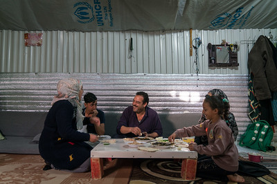 Jordan. Blind Syrian Musician teaches youth in Azraq Refugee Camp.