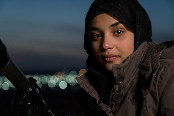 Young refugee in Azraq studies the night sky.