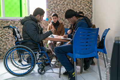 Ameen, 17 year old Syrian refugee living in East Amman, Jordan. Ameen is in a wheelchair from birth and is unable to attend normal school in Jordan due to lack of access for special needs.  He attends a local Makaani cneter when he can get a ride there. He wants to one day onw a mobile phone shop but up till now now one wants to train him since he is not completely school.