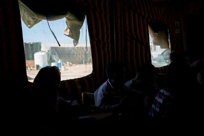 "Mobile ""Makani"" center providing basic education in a an informal tent settlement home to Syrian refugee  south of Amman, Jordan."