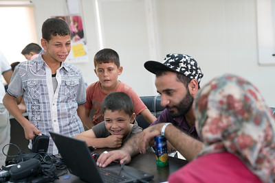 Saturday Aug 27.  Young Syrian regugee children having fun reviewing pictures they took in a photo workshop.