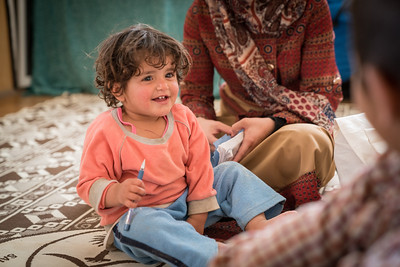 Family in their caravan in Za'atari Refugee camp in Jordan.
