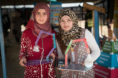 "Anwar, 14 years, and Dina, 15 years, with their invention – a lamp powered by a power bank to help children in Za'atari Refugee Camp to do their homework when there is no electricity. The girls presented their idea, developed in the UNICEF Innovations Lab, at Start-Up Za'atari, an event hosted by UNICEF and The One Foundation.  ""Our hope is for the workshop is to spread out idea until it's in every house in Za'atari,"" said Dina.  ""Girls have a harder time in the camp. By our nature, girls are innovative but we are also shy,"" said Anwar. ""We are here as an example to other girls to show how we can use our creativity.""  ""I want to become a journalist because I like photography and want to tell people's stories to show how difficult life is here so we can get more help,"" said Dina."