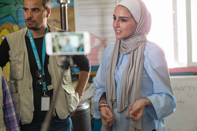 Aseel Qawasmi, (light blue top) a fashion designer in Jordan, leads a workshop on fashion design for Syrian youth in Za'atari Refugee Camp, at Start-Up Za'atari, an event hosted by UNICEF and The One Foundation.