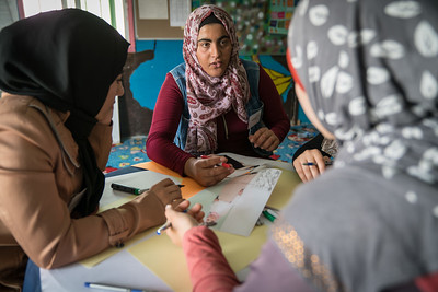 "Iman, 17, taking part in a fashion design workshop in Za'atari Refugee Camp, at Start-Up Za'atari, an event hosted by UNICEF and The One Foundation. ""I came here today to get a glimpse of what the fashion industry is because, just maybe, I can become a fashion designer in the future,"" said Iman. ""We feel honoured and proud to have a real fashion designer who really helped us by sharing her experience. Now we understand the challenges of the industry."" Iman's group designed a dress, incorporating a cape with feathers. ""We decided to come up with one idea. We wanted to have a message embedded in our design. So, we designed a dress with a cape on the back. The material resembles feathers. We want to empower women with our design."""