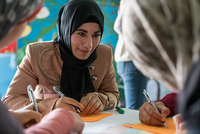 Ikhlas, 18, taking part in a fashion design workshop in Za'atari Refugee Camp, at Start-Up Za'atari, an event hosted by UNICEF and The One Foundation. Her group designed a dress, incorporating a cape with feathers to represent freedom and women's empowerment.