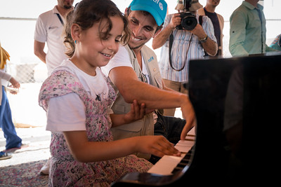 "On the 21st of August, Zade, the newly appointed UNICEF Regional Ambassador for the Middle East and North Africa made his first field visit to Zatari refugee camp and nearby town of Mafraq, accompanied by a grand piano, to bring music and a message of hope to children and youth, including those who have fled war and violence in Syria. He visited a UNICEF supported ""Makani"" centre, which provides learning opportunities, life skills and psychological support to children and youth. Here he is playing with a young Syrian girl named Touka.  Some 300 children and adolescents watched him play. Makani – Arabic for My Space – is an innovative approach developed by UNICEF and funded through the EU's Madad Trust Fund to address the needs of Syrian refugee children and youth as well as vulnerable host communities.   With more than 200 centres throughout Jordan, it's a one-stop location that provides learning opportunities, psychosocial support and better integration for children and youth. It's in line with the ""No Lost Generation"" initiative to address the needs of millions of children impacted by the crises in Syria and Iraq."