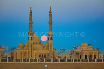 Full Moon Setting behind Al Qasimia University Mosque