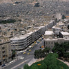 ca. 1975-1995, Damascus, Syria --- The multistoried buildings of downtown Damascus sit in the shadow of a desert hill. Damascus, Syria. --- Image by © Charles & Josette Lenars/CORBIS