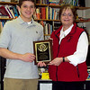 1/27/09: Mrs. Mersky presents the Martin Mersky Memorial Football Award to Robert G.  (Photo by Mr. Stephens)