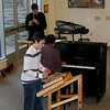 10/31/08: Zach R. plays hammered dulcimer for 8th grade morning meeting, accompanied by Mr. Newberger on piano and Mr. Solonynka on pennywhistle.