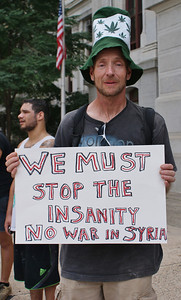 About 200 protesters marched through center city Philadelphia in opposition to a US attack on Syria. (8/31/13)