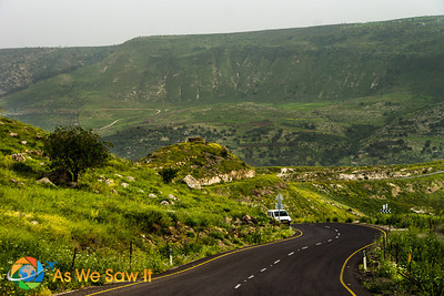Road leading down the other side of the Golan Heights... In the distance is Jordon.