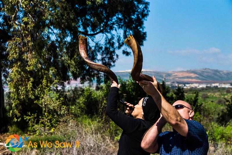 Couple sounding their shofars at Tel Dan Nature Reserve