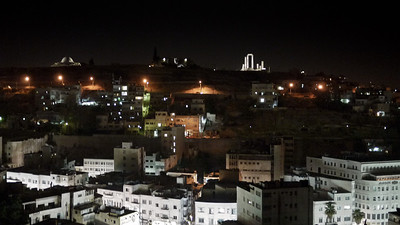 Amman's skyline at night, with the citadel glowing over the city. in Amman, Jordan