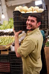Huge smile from a vendor at the veggie market in Amman, Jordan