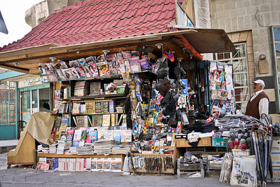 A busy and loaded up corner magazine stand in Amman, Jordan