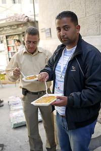 Ali and Rami enjoying knafe in Amman, Jordan