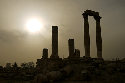As the sun goes behind the clouds late afternoon shadows darken the columns of the Amman Citadel, Jordan