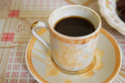 Finishing the meal with a small cup of strong Arabic and cardamom coffee.