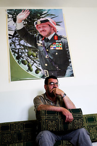 A Druze man sitting under the King in his home.