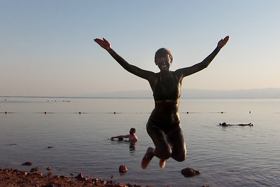 Covered in Dead Sea mud from head to toe and on the shores of Jordan's side.