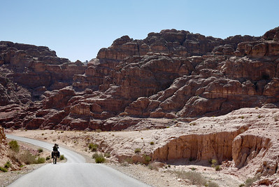 A horse and Bedouin ride out from the ancient city of Petra, Jordan.