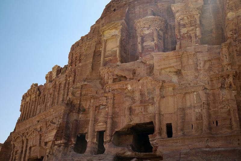 A tall and intricately carved tomb in Petra, Jordan.