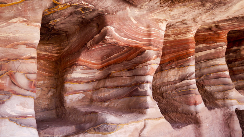 Inside some of the carved-out rooms it's possible to see the gorgeous layers of sandstone in Petra, Jordan.