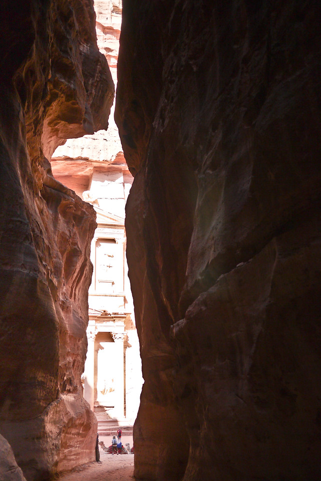 A peep-hole through the Siq as you approach the Treasury in Petra, Jordan.