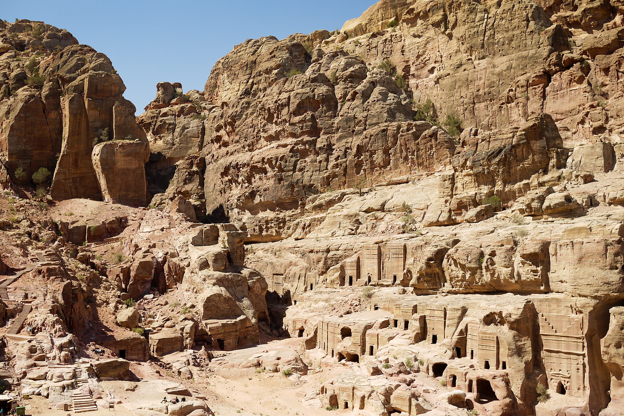 Small homes and structures carved right into the rocks line all of Petra, Jordan.