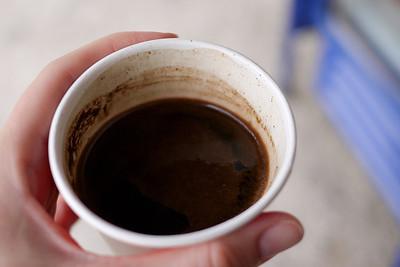 A small cup of pitch-black Arabic coffee in Jordan