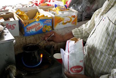 A Jordanian man prepares fresh and hot coffee!