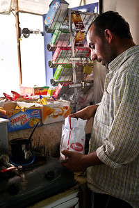 A quick stop at a street-side shop for fresh Arabic coffee, Jordan