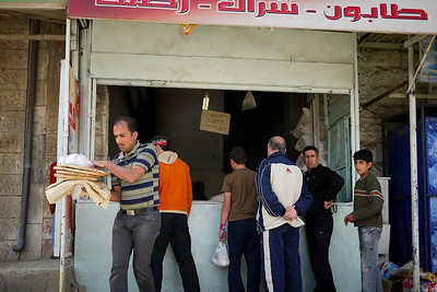 Visiting the local shop in town for a stack of pita bread, Jordan