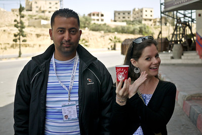 Jodi and Ali show a lovely cup of Arabic coffee at a street side shop in Jordan